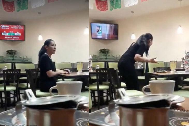 Mujer discute al vacío en un restaurante.