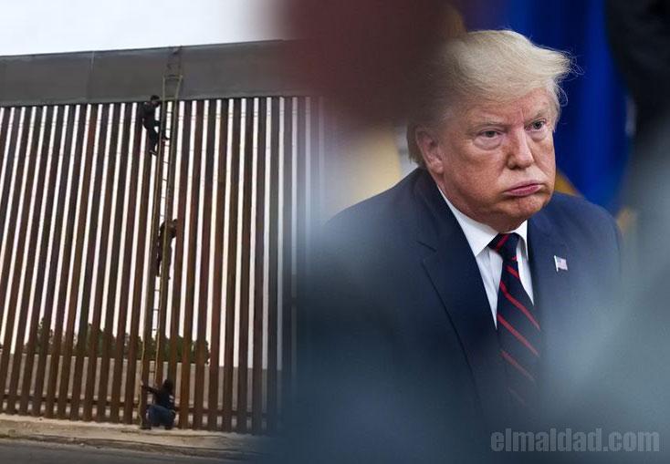 Migrante saltando el nuevo muro de Trump.