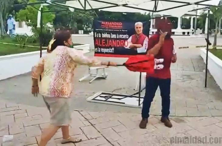 Señora contra militantes de Morena.