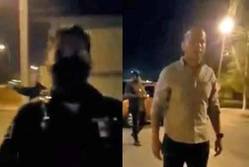 Policía le pide su nombre al sujeto que grababa y no se lo da. A la derecha, Abraham Medina.